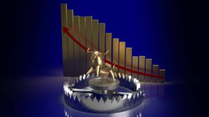 Byk złapany w sidła i wykres ze spadkiem ceny w tle